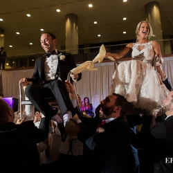 Bride and groom are hoisted in the air during the horrah to music provided by Java Band