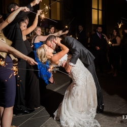 Bride and groom exit through a sea of sparklers after their wedding at Founders Hall