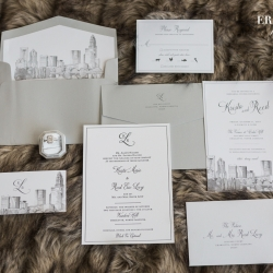 Stunning invitation suite for a an Uptown Charlotte wedding feature the iconic city skyline