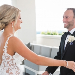 Groom is all smiles as he sees is bride during their first look captured by Erin Kranz Photography
