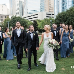 Erin Kranz Photography captures a bridal party walking toward their uptown wedding at Founders Hall