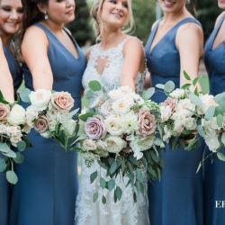 Bride and her bridesmaids show off their bouquets created by Springvine Design