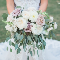 Amazing bridal bouquet features soft lilac flowers and lush cascading greenery created by Springvine Design
