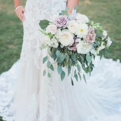 Amazing lace dress and stunning bridal bouquet are the perfect subjects for Erin Kranz Photography