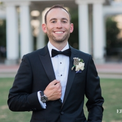 Groom is all smiles as he prepares for his fall wedding planned and coordinated by Magnificent Moments Weddings