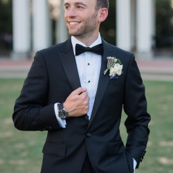 Groom smiles for Erin Kranz Photography during his wedding coordinated by Magnificent Moments Weddings