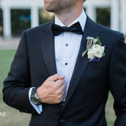Erin Kranz Photography captures the details of a grooms suit on his wedding day in Uptown Charlotte