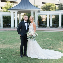 Bride and groom pose in Uptown Charlotte for Erin Kranz Photography before their wedding at Founders Hall