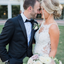 Erin Kranz Photography captures a loving moment between a bride and groom in the Uptown Charlotte
