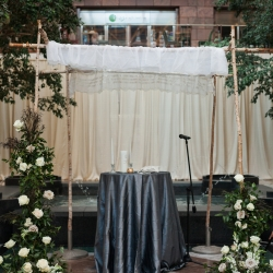 A Jewish Chuppah is the perfect ceremony space accented by lush greens and florals designed by Springvine Design