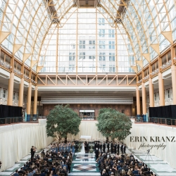 Erin Kranz Photography captures the stunning ceremony space of Founders Hall as a couple exchange vows