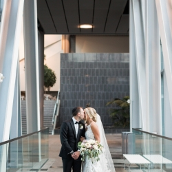 Erin Kranz Photography captures a sweet moment between a bride and groom during their wedding at Founders Hall
