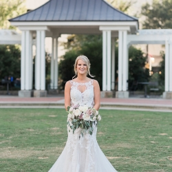Bride poses for Erin Kranz Photography during her Uptown Charlotte Wedding