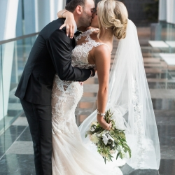Groom dips his bride as Erin Kranz Photography captures a loving moment between the couple
