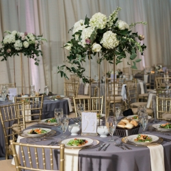 Tall cascading floral centerpieces created by Springvine Design are the perfect accents to a modern wedding in Uptown Charlotte