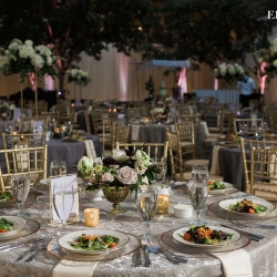 Gray linens and gold chavari chairs rented from Party Reflections create a sleek modern look for a wedding at Founders Hall