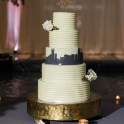 Amazing four tiered cake created by Celestial Cakery is captured by Erin Kranz Photography for during an Uptown Charlotte Wedding