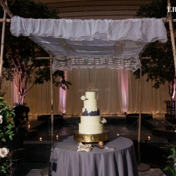 The couples ceremony chuppah became the perfect place to display their amazing cake created by Celestial Cakery