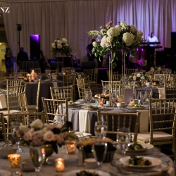 High and low floral centerpieces were the perfect accents for an Uptown Charlotte Wedding designed by Springvine Designs