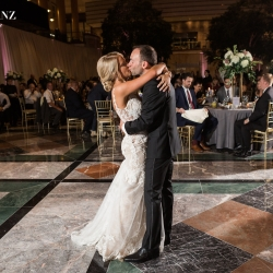 Bride and groom share a kiss during their amazing first dance planned and coordinated by Magnificent Moments Weddings