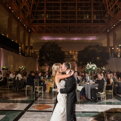 Bride and groom share a kiss during their sweet first dance under the amazing ceiling of Founders Hall