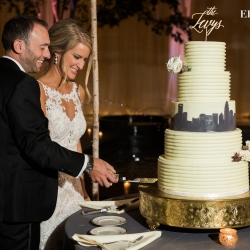 Erin Kranz Photography captures the couples cake cutting coordinated by Magnificent Moments Weddings