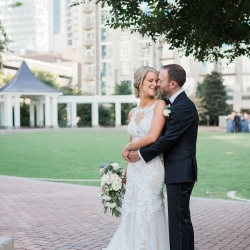 Bride and groom share a sweet moment captured by Erin Kranz Photography