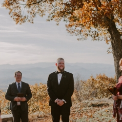 The stunning mountains of Asheville, North Carolina create an amazing ceremony space for a wedding designed by Magnificent Moments Weddings