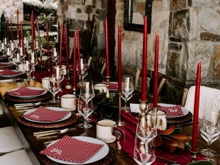 Intimate reception features burgundy accents and farmhouse tables for a fall wedding in Asheville, North Carolina coordinated by Magnificent Moments Weddings