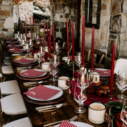 Burgundy tapered candles give a sense of elegance to a rustic mountain wedding in Asheville, North Carolina designed by Magnificent Moments Weddings
