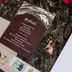 Folk and Wayfarer Photography captures details shots of wedding details include bridal jewelry, invitations, and cat themed escort car holders