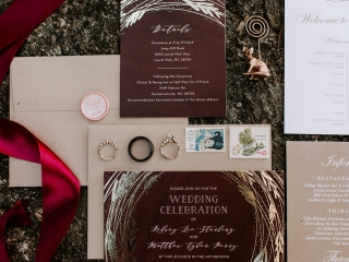 Invitation suite for an Asheville wedding features deep gray tones with floral accents