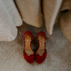 Brides burgundy shoes captured by Folk and Wayfarer Photography for a fall wedding in Asheville, North Carolina