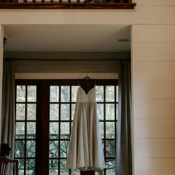 Brides dress is displayed in a mountain cabin before her fall wedding in Asheville, North Carolina