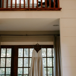 Folk and Wayfarer Photography captures a detail shot of a brides dress before her fall North Carolina wedding