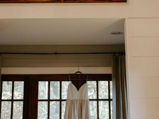 Folk and Wayfarer Photography captures a detail shot of a brides dress before her fall North Carolina wedding