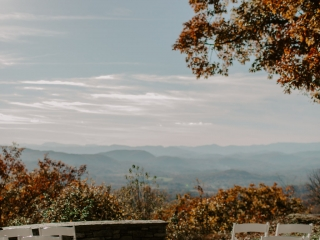 Stunning ceremony space for a mountain wedding in Asheville, North Carolina during a fall wedding designed by Magnificent Moments Weddings
