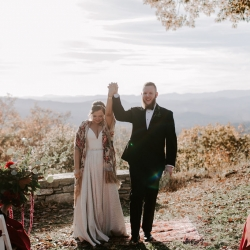 Bride and groom celebrate after exchanging vows in the Mountains of Asheville. North Carolina