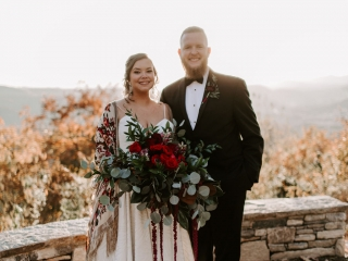 Bride and groom pose before the North Carolina Mountains before their wedding designed by Magnificent Moments Weddings