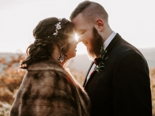 Folk and Wayfarer Photography captures a stunning shot of a bride and groom as the sun sets over the North Carolina Mountains