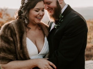 Bride and groom smile after their mountain ceremony at Jump Off Rock in Asheville, North Carolina