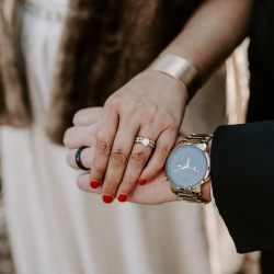 Folk and Wayfarer Photography captures a detail shot of a bride and groom wearing their new rings after their mountain ceremony in Asheville, North Carolina