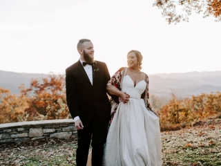 Folk and Wayfarer Photography captures a sweet moment between a bride and groom as they prepare for their wedding at Jump Off Rock in Asheville, North Carolina