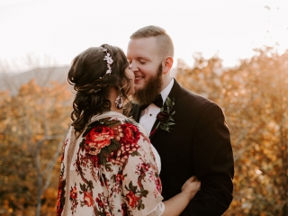 Bride and groom share a kiss before their mountain wedding in Asheville, North Carolina coordinated by Magnificent Moments Weddings