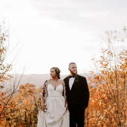 Folk and Wayfarer Photography captures a bride and groom as the pose before the stunning North Carolina Mountain range in Asheville, North Carolina