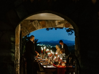 Detail shot of a reception table showing off the stunning view of the North Carolina mountains during a wedding at Jump Off Rock
