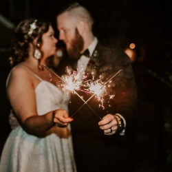 Folk and Wayfarer Photography captures a bride and groom celebrating their Asheville wedding with sparklers