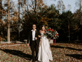 Bride is escorted down the aisle to her Asheville, North Carolina mountain wedding