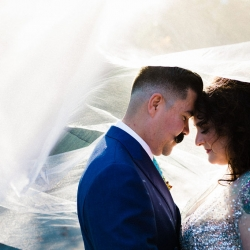 Gandee Photography captures a stunning picture of newly married couple under a gorgeous veil
