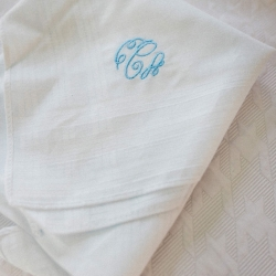 Custom handkerchief features the brides monogram in a pale blue shade